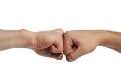 Puño contra el puño Foto de archivo libre de regalías