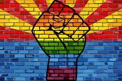 Puño de la protesta de LGBT en una bandera de la pared de ladrillo de Arizona libre illustration