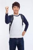 Puño que muestra stdudent asiático joven. Imagen de archivo libre de regalías