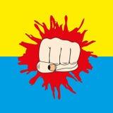 Puño y bandera de la Ucrania Foto de archivo libre de regalías