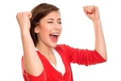 Puños de apretón emocionados de la mujer Imagen de archivo