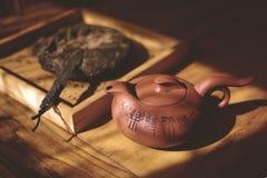 Pu`er tea and Teapot. Pu`er tea and Yixing clay teapot royalty free stock images