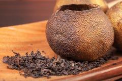 Pu-erh, Chinese dark tea in mandarins. Pu-erh, Chinese dark tea packed in dried mandarins Stock Images