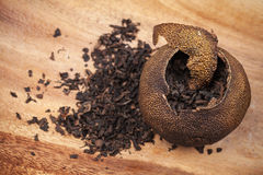Pu-erh. Chinese tea in dried mandarin Stock Images