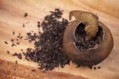 Pu-erh. Chinese tea in dried mandarin Stock Images