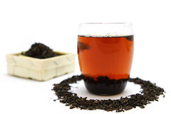 Pu-Erh tea. Glass of Pu-Erh tea and tea-box Royalty Free Stock Image
