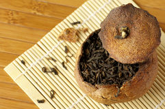 Pu-erh tea aged in tangerine Royalty Free Stock Image