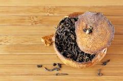 Pu-erh tea aged in tangerine Stock Image