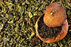 Pu-erh tea aged in tangerine and green tea. Pu-erh tea aged in tangerine on pile of green tea. Top view point Royalty Free Stock Photo
