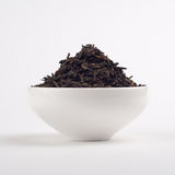 Pu-erh tea leaves. In a white bowl Stock Photography