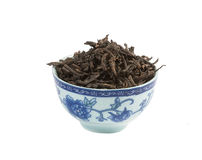 Pu-erh tea,  loose leaf, isolated. Pu-erh tea in the Bowl,  loose leaf, isolated Stock Photo