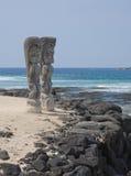 Pu'uhonau o Honaunau National Park, Hawaii. Two carved tikis on the beach at Pu'uhonau o Honaunau National Park, on the Big Island, Hawaii Stock Image
