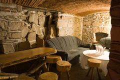 Pub. Image from a romanian pub with handmade wooden futrniture royalty free stock images