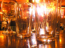 Pub. Empty glasses in a pub Royalty Free Stock Photography