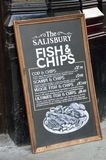 Pub Blackboard sign advertising traditional English Meal of Fish and Chips Royalty Free Stock Image