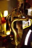 Pub copper taps stock images