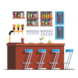 Pub with counter, stools, drinks and glass bottles Royalty Free Stock Photo