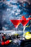 Pub details - alcoholic cocktail with vodka and gin, cosmopolitan long drink in premium glass. Es stock image