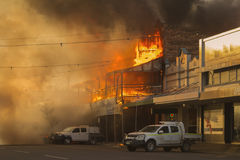 Pub on fire. Drinking establishment, pub, on fire with dark smoke and huge flames Stock Images
