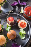 Pub food, mini beef burgers Royalty Free Stock Images