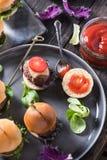 Pub food, mini beef burgers Royalty Free Stock Images