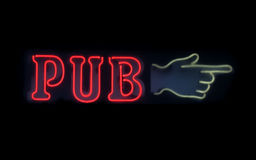 Pub - glowing neon sign. Direction to pub, a glowing neon sign on black stock photos