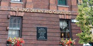 Pub` Hung Drawn och Quartered `en som lokaliseras i stad av London den near tornkullen arkivfoto