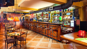 Pub interior. Interior of a modern pub in orange and wooden colors Stock Photography