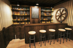 Pub interior side. Side view of a wooden pub interior with empty blackboard. 3D Render Royalty Free Stock Images