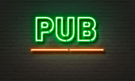 Pub neon sign on brick wall background. Royalty Free Stock Photo