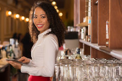 Pub owner. Smiling female pub owner with digital tablet looking at camera Stock Images