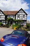 Pub and Porsche Boxter, Pembridge. Royalty Free Stock Images