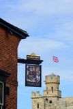 Pub sign with castle in background Royalty Free Stock Image