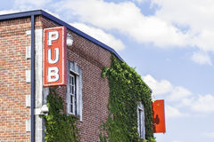 Pub Sign 2. A pub sign located on the side of a brick building royalty free stock photos