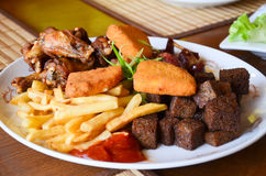 Pub snack. Plate with assorted pub snack on the table Royalty Free Stock Image