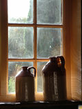 Pub Window. Sunlit jugs in pub window royalty free stock photo