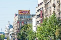 Pubblicità di Coca-Cola sulla costruzione di appartamento Fotografia Stock