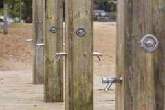 Pubic showers in a row. Public showers in Gandario beach Sada, La Coruna - Spain royalty free stock images