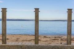 Pubic showers in a row. Public showers in Gandario beach Sada, La Coruna - Spain royalty free stock image