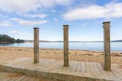 Pubic showers in a row. Public showers in Gandario beach Sada, La Coruna - Spain stock photo