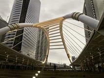 Pubic skywalk with modern buildings Stock Photos