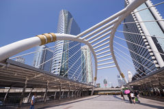 Pubic skywalk with modern buildings of Bangkok Stock Photos
