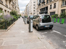 Public access electric cars parked along a Paris street Royalty Free Stock Image