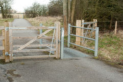 Public access gates and styles. Wood and metal controlling ingress to public areas royalty free stock photos
