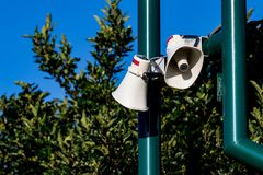 Public address bullhorn outdoor speakers on a green Royalty Free Stock Photography