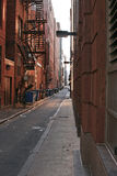 Public alley. In boston showing brick buildings, dumpsters and fire escape Stock Photo