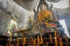 Public ancient Thai Buddha statue left in the forest for hundred years in Wat Somdej temple Stock Photography