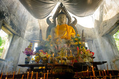 Public ancient Thai Buddha statue left in the forest for hundred years in Wat Somdej temple . Stock Images