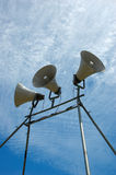 Public Announcement System. Loudspeakers against the bright blue sky royalty free stock photo