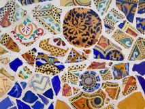 Public Art: Mosaic. Travel Destination, Barcelona, Spain: Detail of Antonio Gaudi's mosaic art in public art landmark, Park Guell Royalty Free Stock Photo